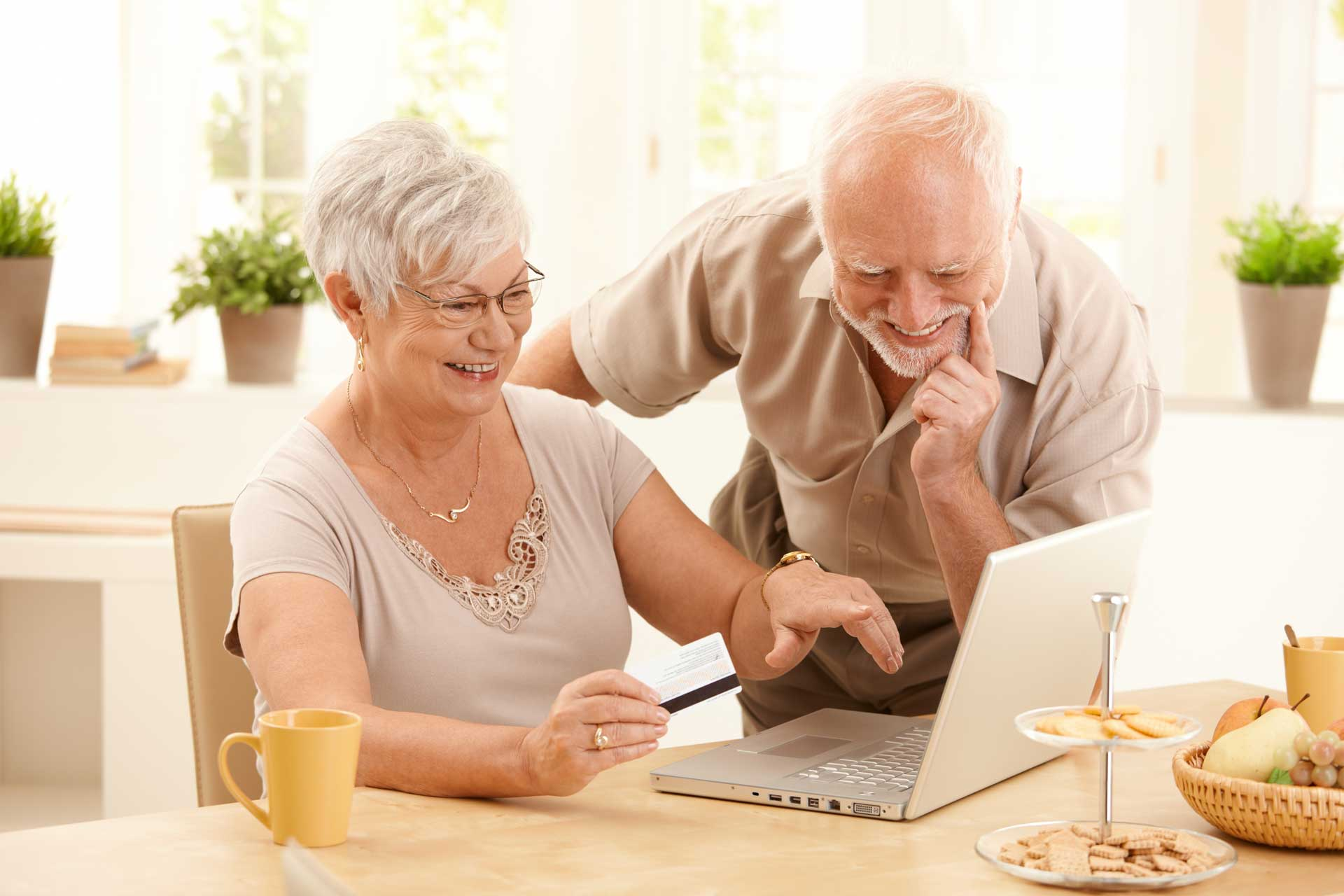 senior couple in front of laptop computer