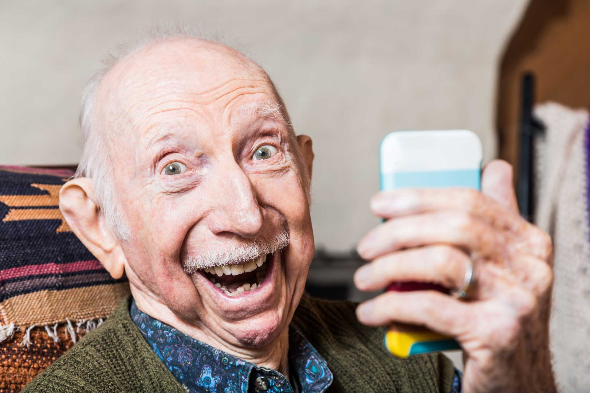 elderly man with mobile phone
